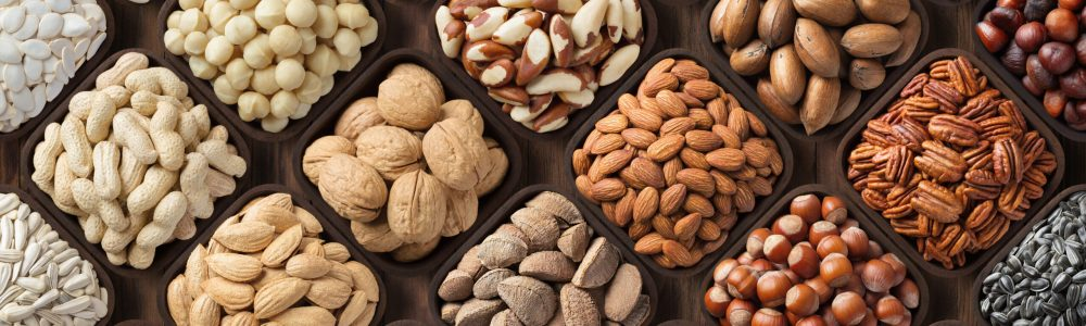 seeds and nuts background, natural food in wooden bowls, top view.