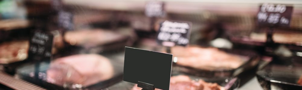 Shelf with fresh chilled meat in food market, nobody. Production of slaughterhouses in supermarket